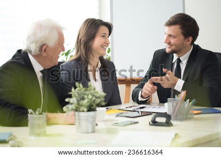 Smiling workers of corporation discussing about job