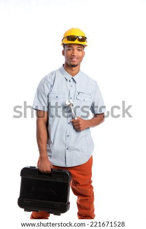 Smiling Young African American  Worker Holding Toolbox and Wrench Isolated on White Background - stock photo