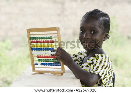 Smiling Young African Child Education Symbol - stock photo