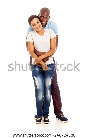 smiling young afro american couple embracing on white background - stock photo