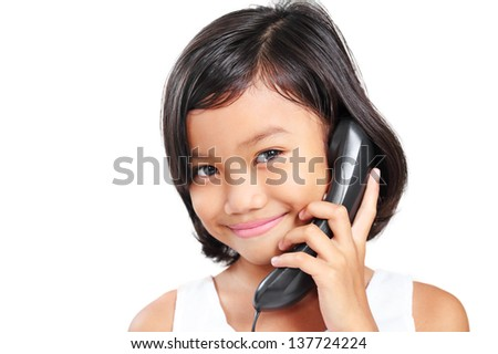 Smiling young asian girl calling on the telephone. - stock photo
