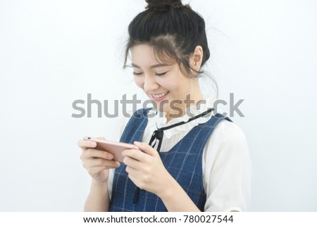 Smiling Young Asian Woman Using Phone and smile