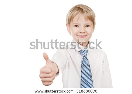 Smiling young  boy hand gesturing thumb up  - stock photo