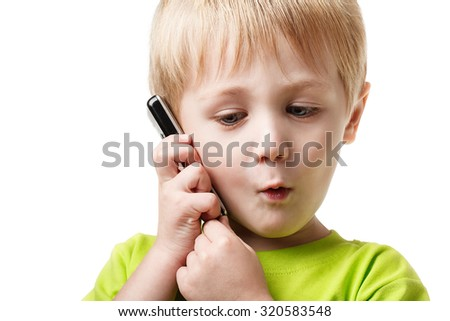 Smiling young boy having a phone call - stock photo