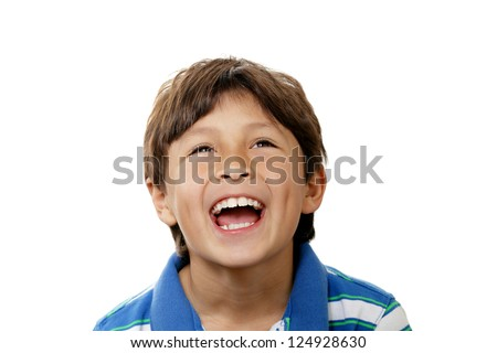 Smiling young boy looks up into copy space on white background