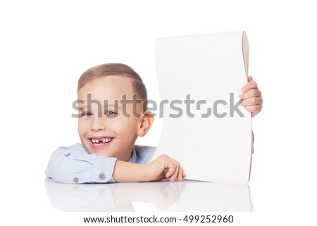 Smiling young boy with blank paper on isolated white