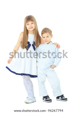 Smiling young brother and sister - stock photo