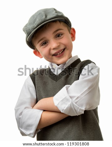 Smiling young brunette caucasian boy with arms crossed wearing a flat cap - stock photo