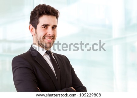Smiling young business man at the office - stock photo