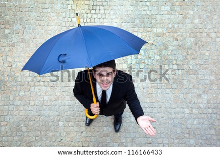 Smiling young business man checking if it's raining