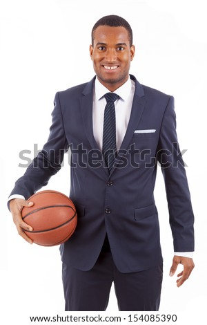 Smiling Young business man holding a basketball, isolated on white
