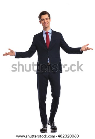 smiling young business man in suit and tie welcoming you on white studio background