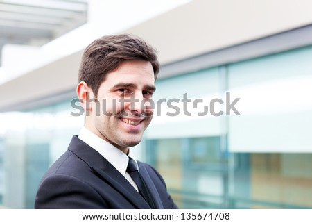 Smiling young business man portrait - stock photo