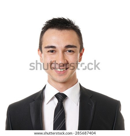 smiling young business man wearing suit and tie - stock photo