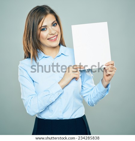 Smiling young business woman hold white business board. blank card. copy space. studio isolated. - stock photo