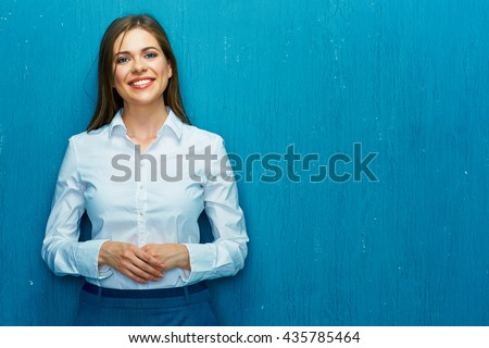 Smiling young business woman portrait on blue wall background. White shirt. - stock photo