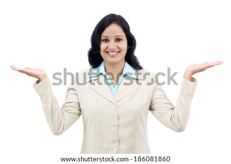 Smiling young business woman showing copy space against white