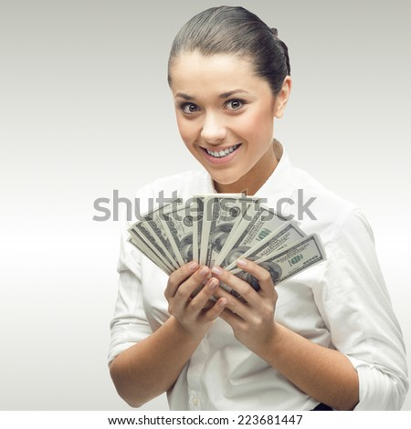 smiling young business woman standing over gray background