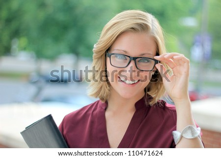 Smiling Young Business Woman Wearing Eye Glasses Looking at the Camera