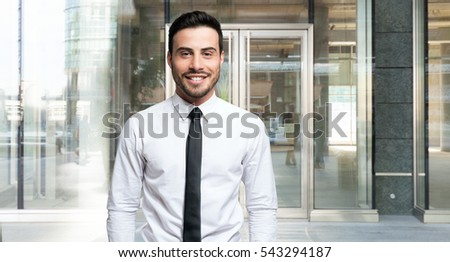 Smiling young businessman portrait. Wide image
