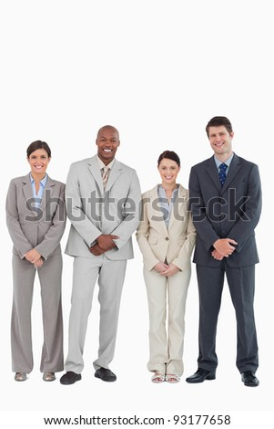 Smiling young businessteam standing together against a white background