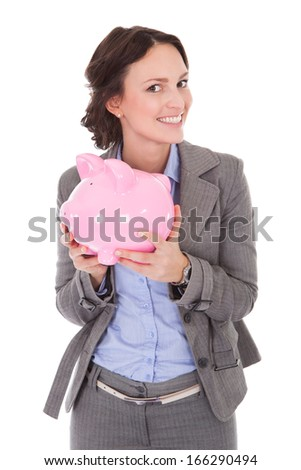 Smiling Young Businesswoman Holding Piggybank Over White Background