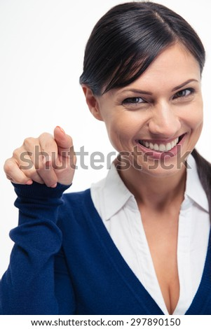 Smiling young businesswoman pointing finger at camera isolated on a white background