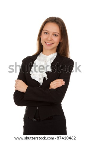 Smiling young businesswoman standing with folded hands. Isolated over white background