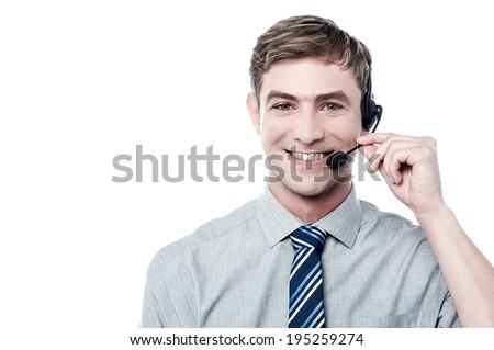Smiling young call center executive - stock photo
