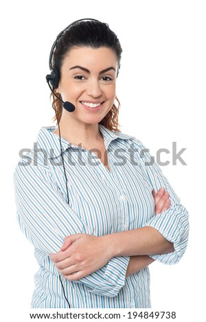 Smiling young call center woman with arms crossed - stock photo