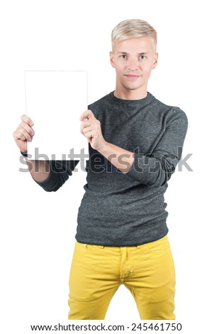 Smiling young casual man holding blank paper - stock photo