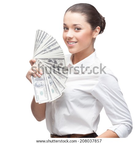smiling young caucasian business woman in white blouse holding money isolated on white