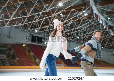 Smiling young couple at skating rink