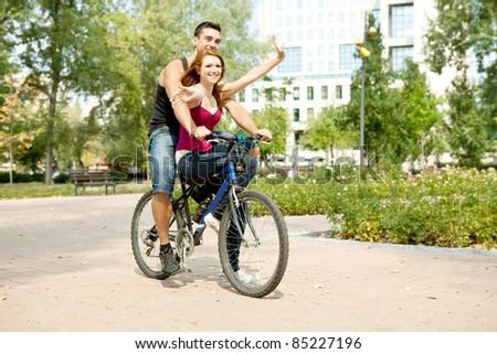 smiling young couple having fun, outdoor - stock photo