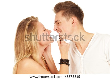 Smiling young couple isolated on a white background