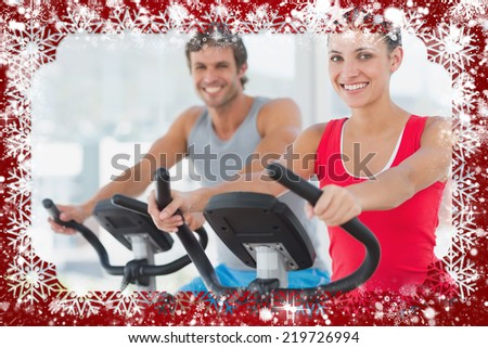 Smiling young couple working out at fitness class against snow