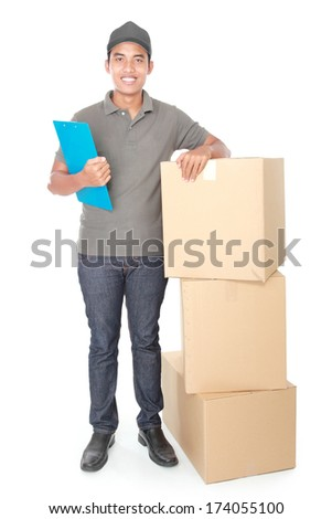 Smiling young delivery man with cardbox package isolated on white background