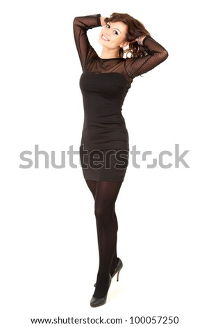 smiling young elegant woman in black dress, full length, white background