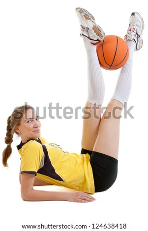 smiling young female basketball player with ball - stock photo