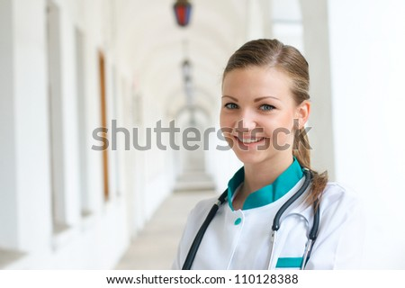 Smiling young female doctor - stock photo