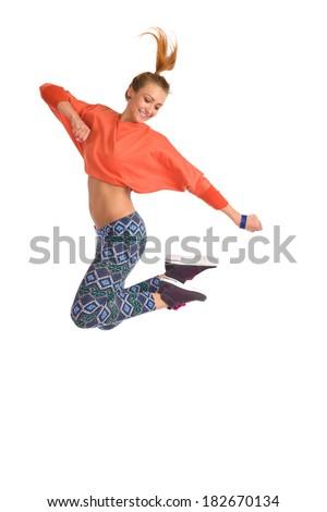 Smiling young female jumping dancing zumba. Full length studio shot on white background. - stock photo