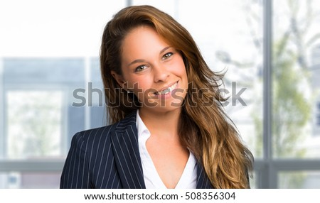 Smiling young female manager in her office