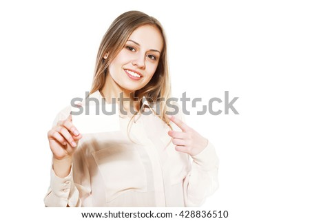 Smiling young female showing blank credit card - stock photo