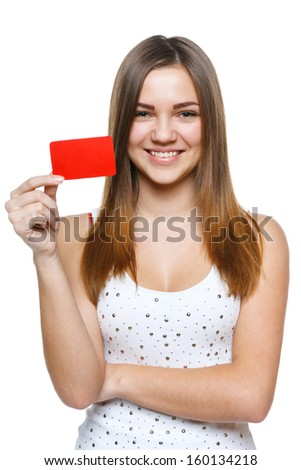 Smiling young female showing blank credit card, isolated on white background - stock photo
