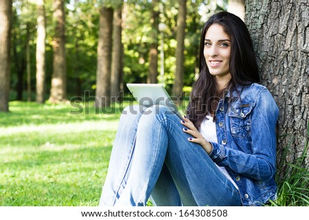 Smiling young female with digital tablet