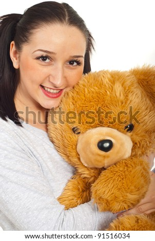 Smiling young female with pigtails holding teddy bear isolated on white background - stock photo