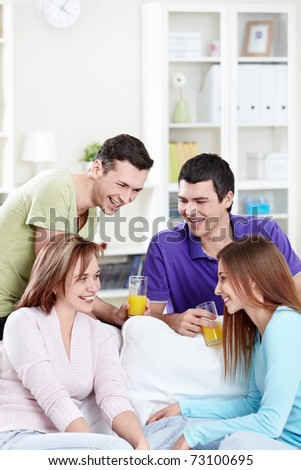 Smiling young friends at home - stock photo