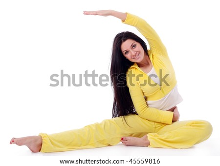 smiling young girl doing fitness exercises - stock photo