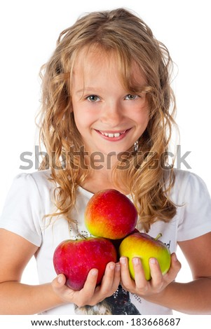 Smiling young girl holding apples