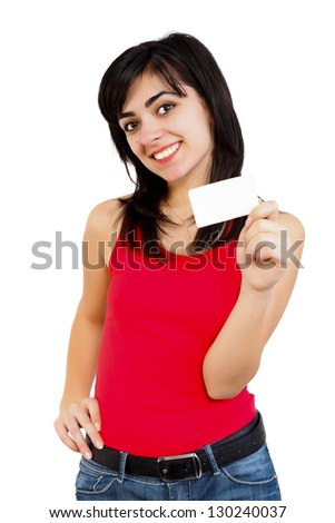 Smiling young girl in red holding a blank card isolated on white.